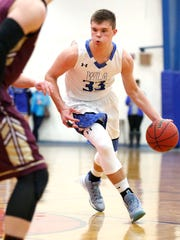 Winnebago Lutheran's Noah Lorenz dribbles the ball during a game last year against Omro.