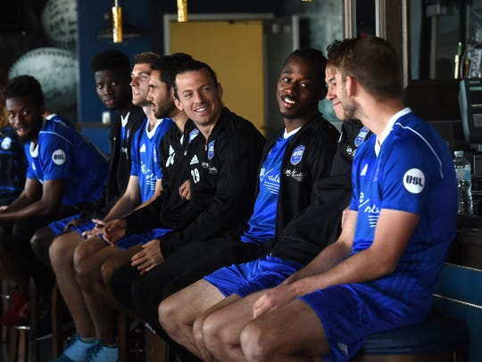 Reno 1868 FC players mingle as they wait for Media