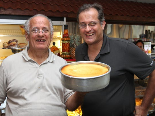 The Pantagis Diner in Edison is known for its cheesecake. Owners Nick Pantagis (left) and his son, Stephen, show one off.