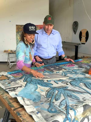 Paula Wilson shares some art techniques with U.S. Sen. Tom Udall on his visit to Carrizozo.