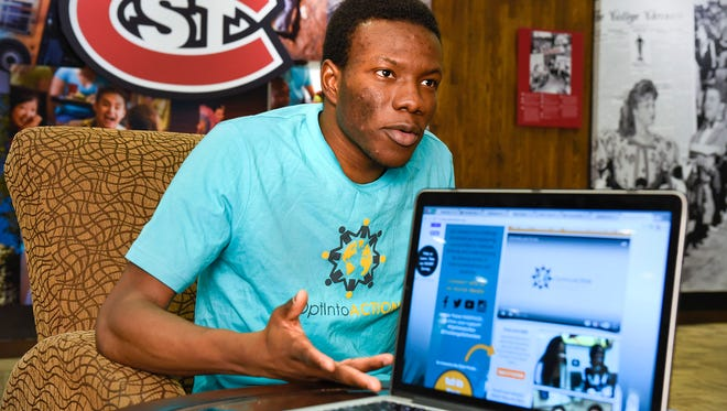 St. Cloud State University student Landry Kabore describes their class project to create a social media campaign to combat violent extremism shown Tuesday, Dec. 6. at SCSU.