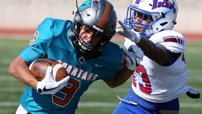Caleb Gerber, 9, of Pebble Hills gets around Carlos Moreno, 13, of Irvin in a play that set up a touchdown Thursday at the Socorro Activities Complex.