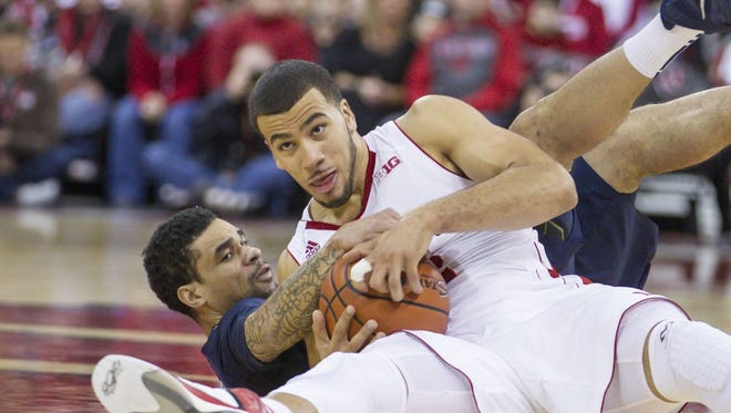 Wisconsin's Traevon Jackson, right, and Penn State's John Johnson battle for a loose ball during the first half of Wednesday's game in Madison.