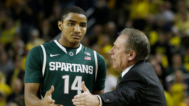 Michigan State head coach Tom Izzo talks to guard Gary Harris (14) during the first half of an NCAA college basketball game against Michigan in Ann Arbor, Mich., Sunday, March 3, 2013. (AP Photo/Carlos Osorio)