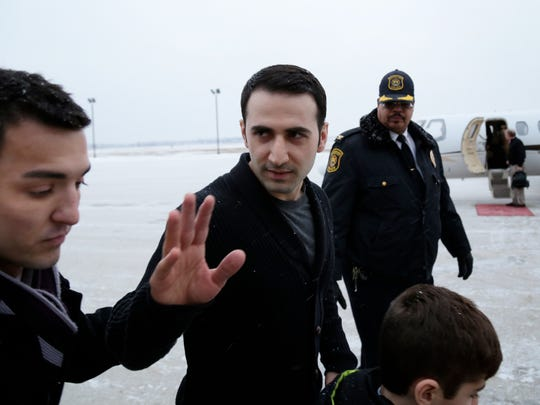 Former U.S. Marine Amir Hekmati, center, 32, arrives at Bishop International Airport on Thursday, Jan. 21, 2016, in Flint.
