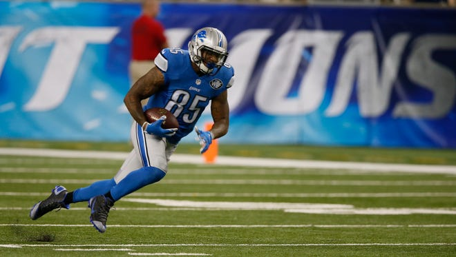 Detroit Lions Eric Ebron picks up a first down after the pass reception in the first quarter against the  New York Jets in their pre season football game on Thursday, August 13, 2015, in Detroit. Julian H. Gonzalez/Detroit Free Press