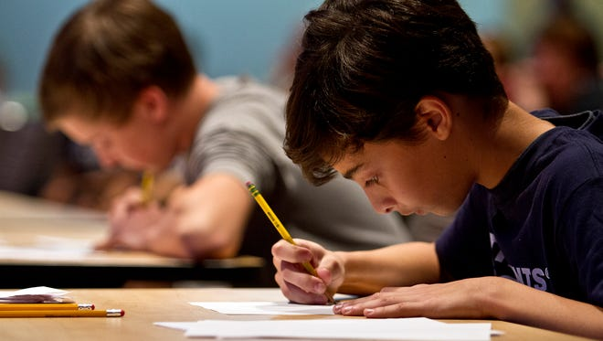 Jordan Hochman, 12, right, a student at Community School of Naples, works on a math problem Saturday afternoon at Florida SouthWestern State College in Fort Myers as he competes against Mike Binkowski, 14, also of Community School of Naples. They were participating in the MATHCOUNTS program. MATHCOUNTS is a nationwide math enrichment, coaching and competition program, which promotes math achievement with the challenge of a school sports event.