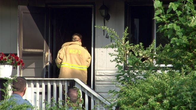 The Monmouth County Fire Marshal's office continue their investigation of a fire on the 100 block of West Fifth Street in Howell Township, Tuesday, May 31, 2016, where a 50-year-old woman and her dog were killed.