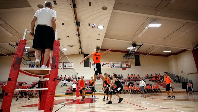 Cedarburg's Michael Beran (5) leaps up to hit against Homestead during the first set of the varsity teams match in Homestead High School in September 2016. This year's match featured a zany 41-39 set won by Cedarburg in a five-set victory.