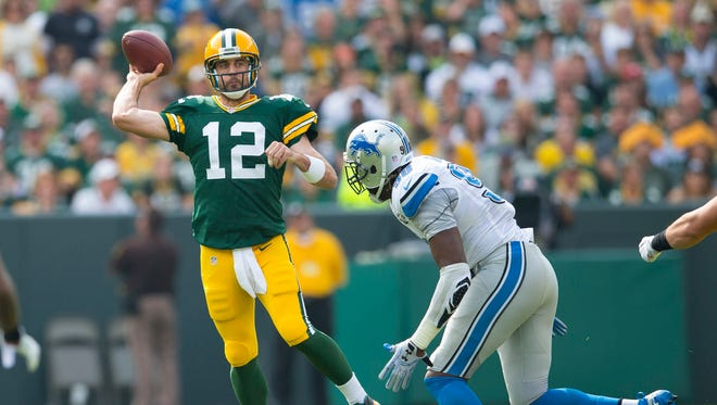 Packers quarterback Aaron Rodgers throws a pass during the first quarter of the Lions' loss Sunday, Sept. 25 in Green Bay.