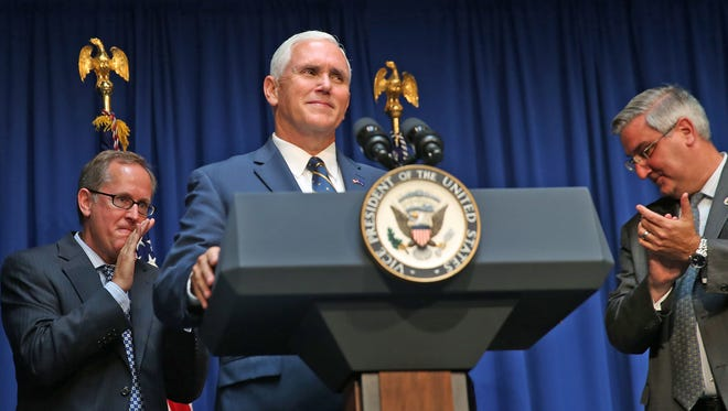 Vice President Mike Pence smiles after being introduced before his Indiana Gubernatorial portrait is unveiled at the Indiana Statehouse, Friday, August 11, 2017.
