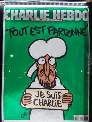A copy of the French satirical magazine Charlie Hebdo, featuring a cartoon of the Prophet Muhammad, sits on display outside the Newseum in Washington, DC, on Jan. 14, 2015.