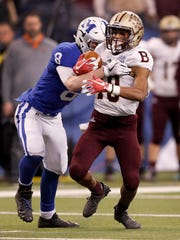 Brebeuf Jesuit Braves Gabe Wright (18) attempts to