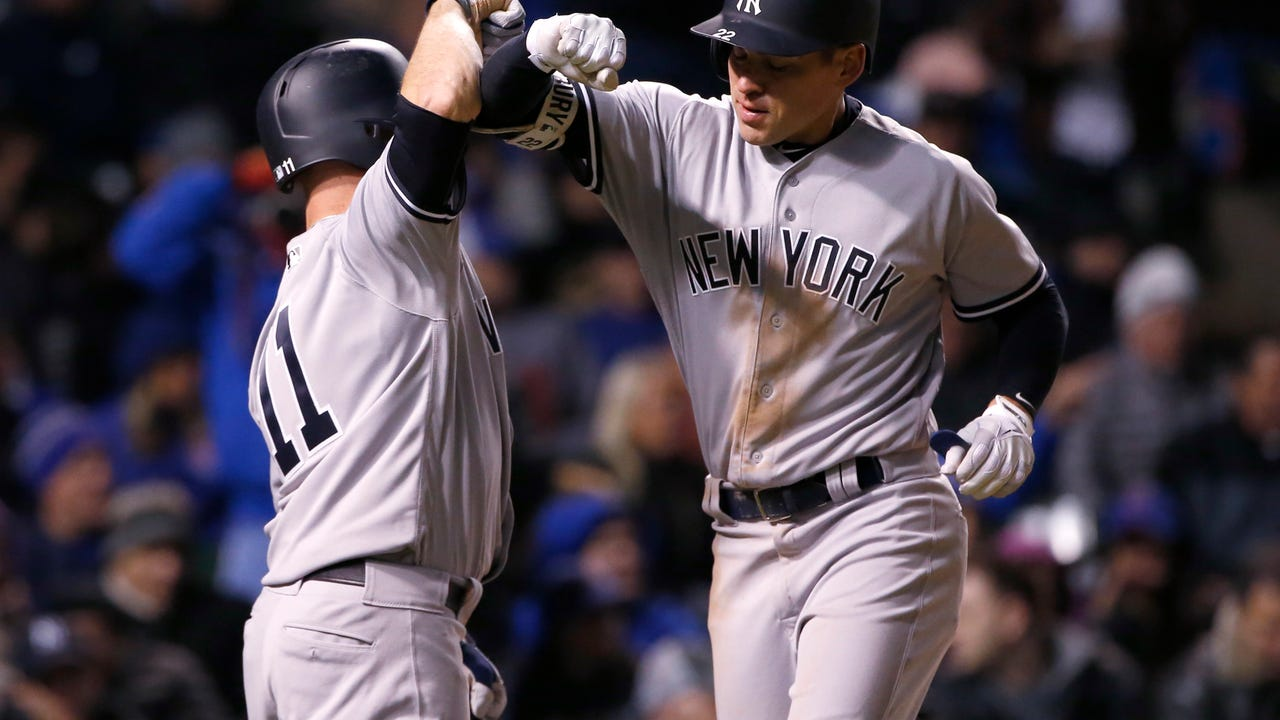 The Yankees outlasted the Cubs 5-4 in an 18-inning marathon game Sunday night.