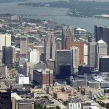 In this July 16, 2013 aerial file photo, the downtown of the city of Detroit is shown. Detroit Emergency Manager Kevyn Orr raised more than a few eyebrows a year ago when he took the city into bankruptcy and predicted it would be out by the time his term expired in fall 2014.