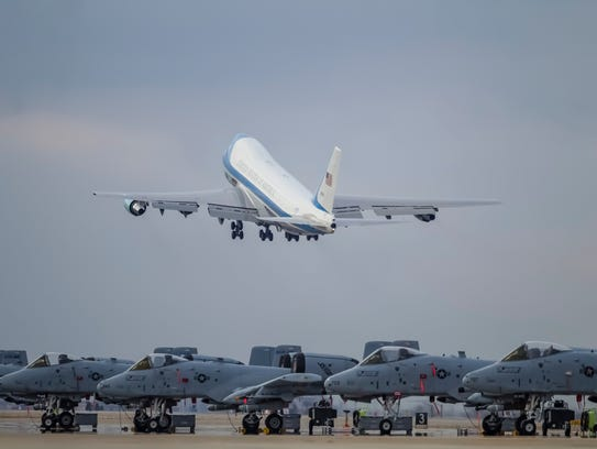 Air Force One departs past a squadron of Fairchild