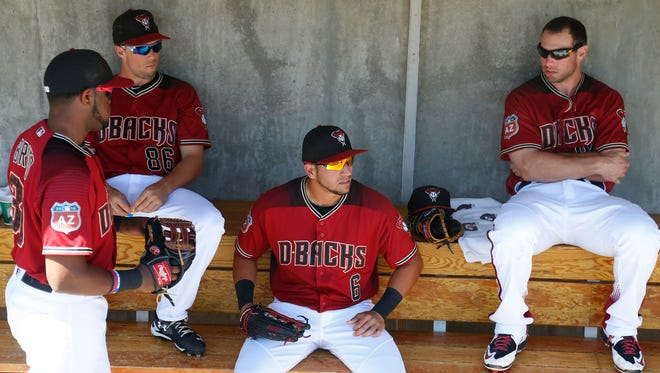Diamondbacks' David Peralta (6) sits with his teammates in the dugout before a game against the Indians at Salt River Fields at Talking Stick on Friday, March 25, 2016.