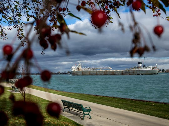 The freighter Cuyahoga passes Nautical Mile park Friday in Marine City. An ice rink will be installed at the park this winter with donated materials.