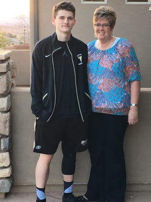 Desert Hills star basketball player Marcus McKone (left) gives all the credit to his mother, Kim McKone, who has supported him the entire way.