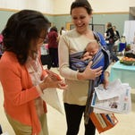 Mary Daugherty, Brighton District Library early literacy specialist speaks with a moms about Books for Babies, which is an outreach reading program for newborns and parents. This was at the Community Baby Shower in late October.