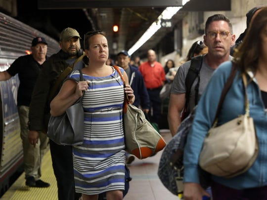 Commuters aboard the 7:30 a.m. Amtrak train from Albany arrive at Grand Central Terminal in Manhattan July 10, 2017. Six Amtrak trains, three in and three out, will be routed into Grand Central Terminal each day as Amtrak performs eight week's worth of repair work over the summer.