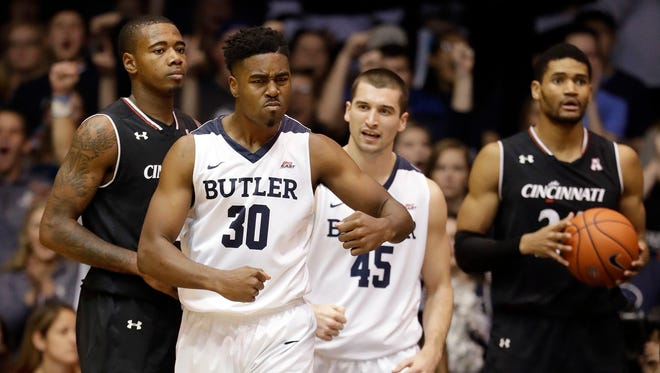 Butler's Kelan Martin (30) celebrates after hitting a basket and being fouled during the second half of an NCAA college basketball game against Cincinnati, Saturday, Dec. 10, 2016, in Indianapolis. (AP Photo/Darron Cummings)