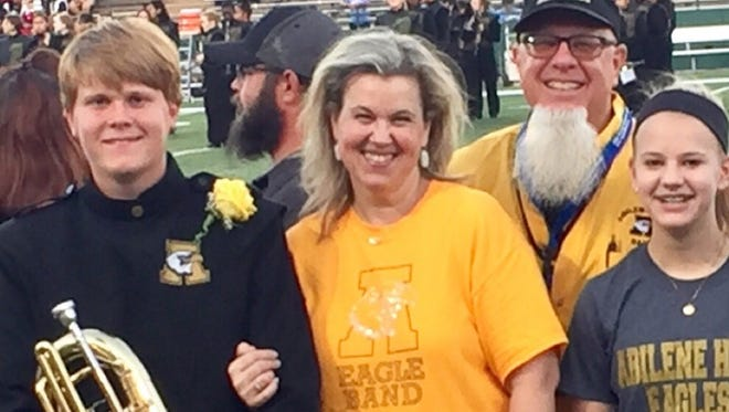 The Jaklewicz family at Abilene High School Eagle Marching Band senior night - musician Jaret, mom Hollye, dad (the other guy with the beard) Greg and daughter and almost Eagle-to-be Aubrey.