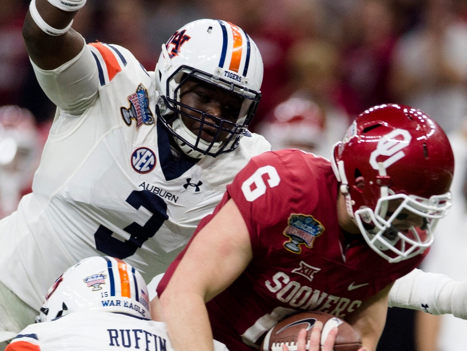 Auburn defensive back Nick Ruffin (19) and Auburn defensive lineman Marlon Davidson (3) tackles Oklahoma quarterback Baker Mayfield (6), but Auburn lost the Sugar Bowl to Oklahoma.