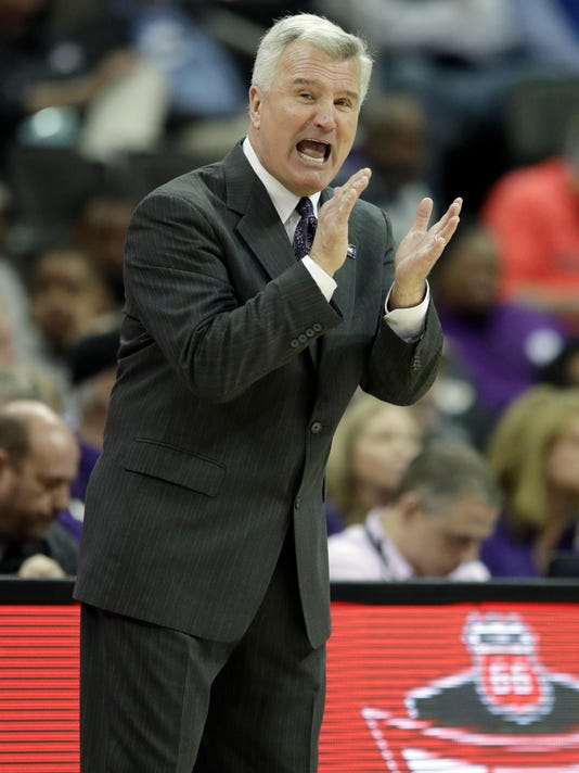 Kansas State head coach Bruce Weber applauds his team during the first half of an NCAA college basketball game against TCU in quarterfinals of the Big 12 conference tournament in Kansas City, Mo., Thursday, March 8, 2018. (AP Photo/Orlin Wagner)
