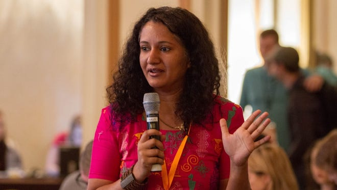 """Hemal Trivedi, co-director of the documentary """"Among the Believers,"""" speaks during the Heartland Film Festival Filmmakers' Brunch on Oct. 25."""