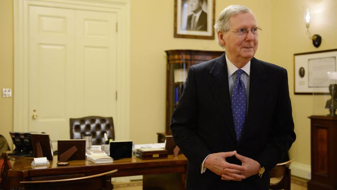 Senate Majority Leader Mitch McConnell is interviewed in his Capitol office in Washington on Jan. 6, 2015.