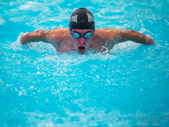 Ben Williams, of Houston High School, competes in the Men's Open 100Y I.M. during prelims at the Shelby County Swimming Championship at St. George's Independent School's Compton Aquatic Center on Saturday morning.