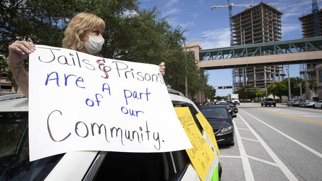 WEST PALM BEACH -- Debra Bennett, of West Palm Beach, joined protesters from Florida Cares, an advocacy group for prisoners in Florida, as they paraded in cars from the State Attorney's Office to the Palm Beach County Jail demanding county leaders be more proactive in releasing certain inmates from the jail to mitigate the spread of the coronavirus.