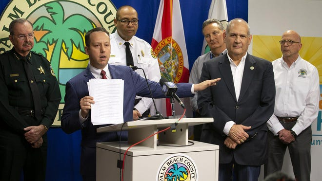 Palm Beach County Mayor Dave Kerner, center, issued a state of emergency March 13 and is reupping it for another week.