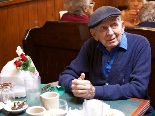 Irving Bauman, 99, brought a meal home to his wife,