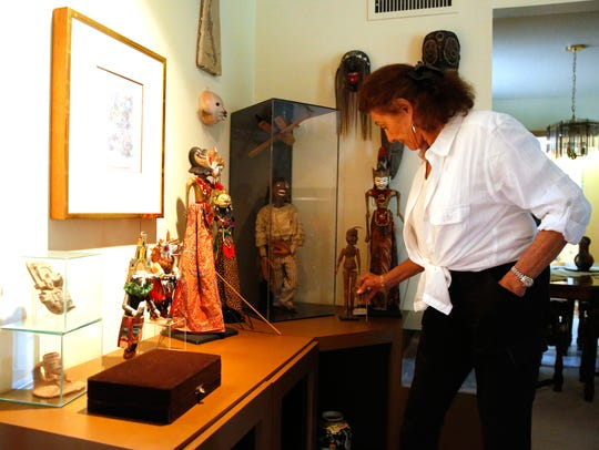 Jan Kaufman browses her collection of marionette puppets