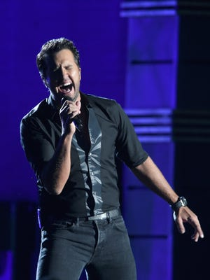 Luke Bryan performs onstage at the 50th annual CMA Awards at the Bridgestone Arena on Nov. 2, 2016, in Nashville, Tennessee.