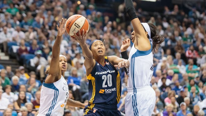Indiana Fever guard Briann January (20) shoots in the first quarter against Minnesota Lynx forward Maya Moore (23) at Target Center.