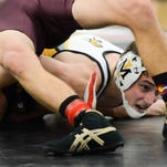Casey Jackson of Merritt Island tries to pin Louis Cortez of Astronaut during the Cape Coast Conference wrestling meet at Bayside High School.