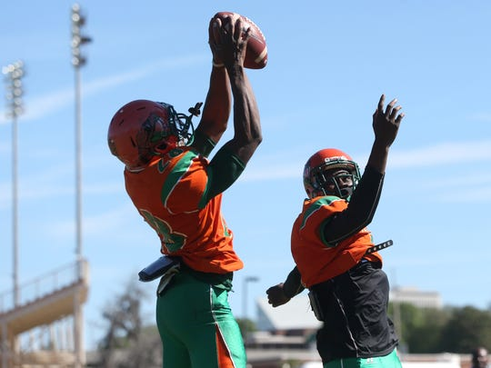 FAMU's Terry Jefferson makes a leaping catch as the