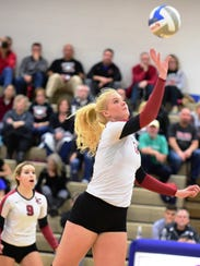 Churchill senior middle hitter Annie Yost tips the