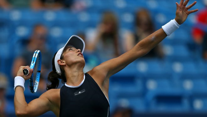 Garbine Muguruza serves against Madison Keys during the Western and Southern Open at the Lindner Family Tennis Center.