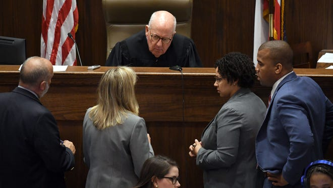 Judge Prentiss Harrell speaks with attorneys in the case of Joshua Miller, who killed Kristin Aultman in 1996, on whether his sentence will include the possibility of parole at the Lamar County Courthouse in Purvis on Tuesday, July 31, 2018.