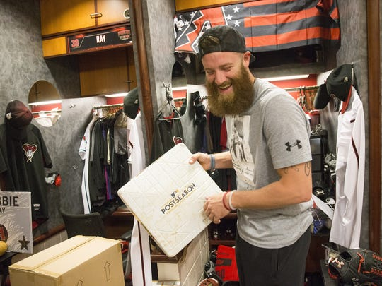 Archie Bradley holds a base from the postseason while