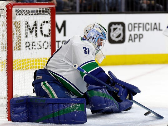 Vancouver Canucks goalie Anders Nilsson stops a shot during the first period of the team's NHL hockey game against the Vegas Golden Knights on Friday, Feb. 23, 2018, in Las Vegas. (AP Photo/Isaac Brekken)