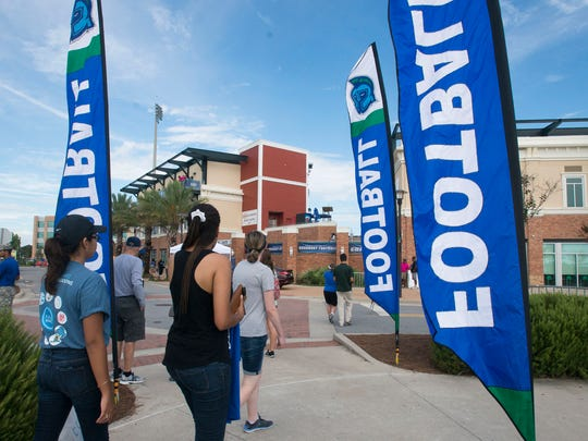 University of West Florida students pass the time before the start of Saturday's first Argo home game with games while tailgating at the Community Maritime Park Saturday afternoon.