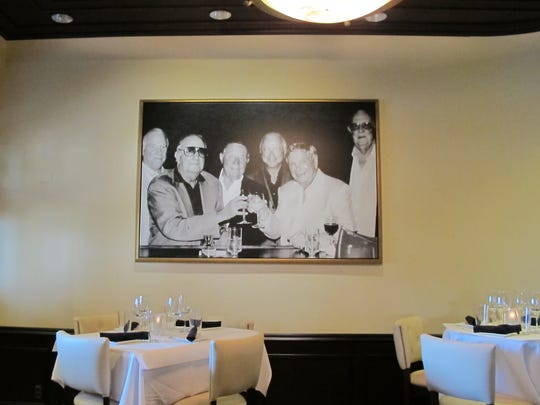 Cloyde Pate and Bob Germain Sr. are in the center of this photo of honorees at the new St. Germain Steakhouse in Naples.
