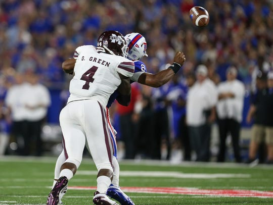 Mississippi State's Gerri Green (4) hits Louisiana