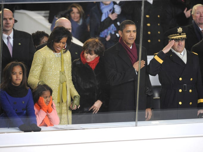 President Barack Obama stands for the pledge of allegiance