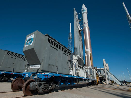 An Atlas V rocket with NASA's TDRS-L satellite rolls to the pad at Launch Complex 41 in January 2014.